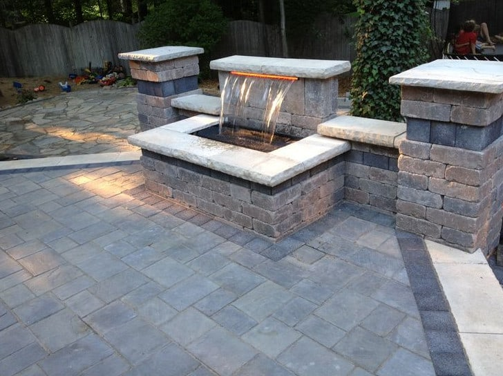 raised patio using unilock brick pavers