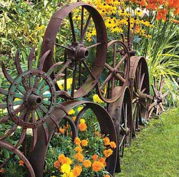 landscape edging with old metal wheels