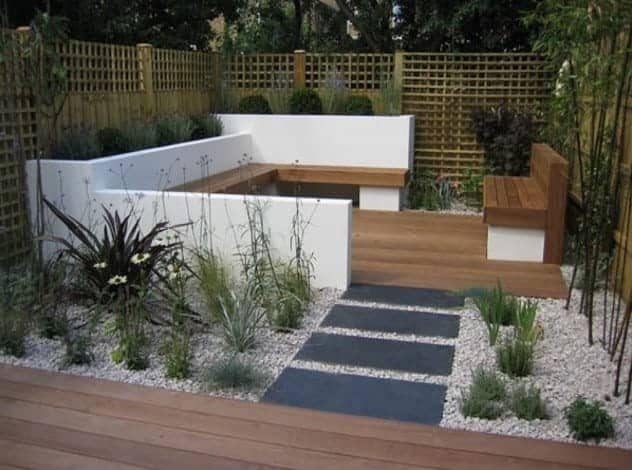 modern garden design with wooden pattern floor and black pathway ideas