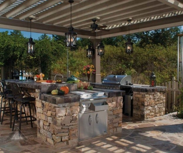 italian style outdoor kitchen and dining area